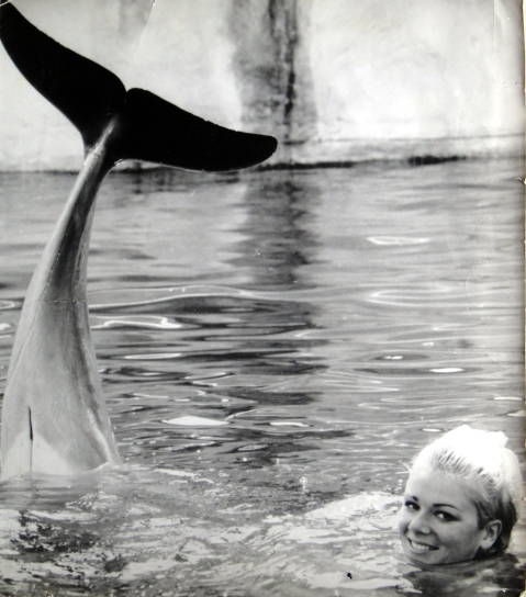 The dolphin girl.Amazing example of synchronicity captured by a leading press photographer.